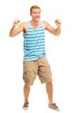 Hombre joven feliz que celebra el éxito aislado en blanco Imagenes de archivo