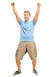 Hombre joven feliz que celebra el éxito aislado en blanco Imagen de archivo
