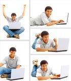 Hombre joven feliz que trabaja en una computadora portátil imagenes de archivo