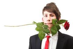 Hombre joven, flor, rosa del rojo aislada Imagen de archivo libre de regalías