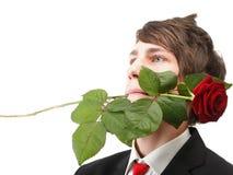 Hombre joven, flor, rosa del rojo aislada Imagenes de archivo