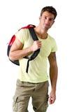 Hombre joven hermoso con la mochila, aislada en blanco Fotos de archivo libres de regalías