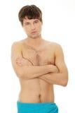 Hombre joven hermoso con la toalla Foto de archivo libre de regalías