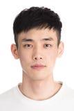 Hombre joven hermoso de Asia - aislado sobre un fondo blanco Fotos de archivo