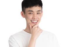 Hombre joven hermoso de Asia - aislado sobre un fondo blanco Fotografía de archivo libre de regalías