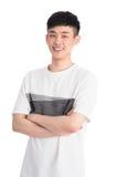 Hombre joven hermoso de Asia - aislado sobre un fondo blanco Imagen de archivo libre de regalías
