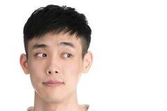 Hombre joven hermoso de Asia - aislado sobre un fondo blanco Imagenes de archivo