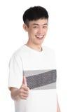Hombre joven hermoso de Asia - aislado sobre un fondo blanco Imagen de archivo
