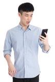 Hombre joven hermoso de Asia - aislado sobre un fondo blanco Fotos de archivo libres de regalías