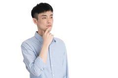 Hombre joven hermoso de Asia - aislado sobre un fondo blanco Imágenes de archivo libres de regalías