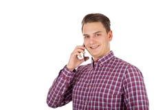 Hombre joven hermoso en el teléfono Imagenes de archivo