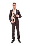 Hombre joven hermoso en traje clásico y con el ABC de las letras Imagen de archivo libre de regalías