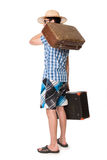 Hombre joven, hermoso en vidrios con dos bolsos listos para viajar Imagen de archivo libre de regalías