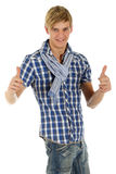 Hombre joven hermoso, pulgares para arriba Fotografía de archivo