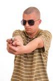 Hombre joven hermoso que señala con el arma del juguete Imagenes de archivo