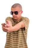 Hombre joven hermoso que señala con el arma del juguete Foto de archivo