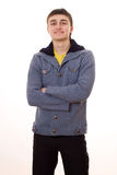 Hombre joven hermoso que se coloca en un fondo blanco Fotografía de archivo libre de regalías