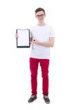 Hombre joven hermoso que sostiene el tablero con el espacio de la copia aislado encendido Imagen de archivo libre de regalías
