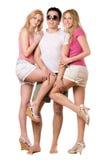 Hombre joven hermoso y dos muchachas juguetonas Fotos de archivo libres de regalías