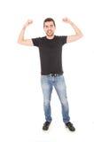 Hombre joven hispánico que presenta con los brazos para arriba Fotografía de archivo