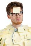 Hombre joven infeliz con una nota pegajosa Fotografía de archivo