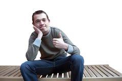 Hombre joven loco con los pulgares para arriba Imagenes de archivo