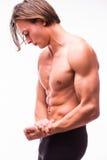 Hombre joven muscular hermoso que mira de lado de presentación el estudio Imagen de archivo libre de regalías