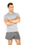 Hombre joven muscular sano aislado en blanco Foto de archivo libre de regalías