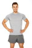 Hombre joven muscular sano aislado en blanco Imagen de archivo