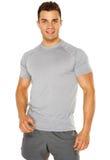 Hombre joven muscular sano aislado en blanco Imagen de archivo libre de regalías