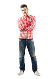 Hombre joven preocupante en camisa de tela escocesa Fotografía de archivo