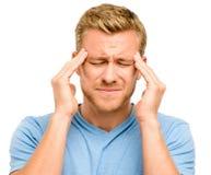 Hombre joven preocupante que sufre de dolor de cabeza Fotografía de archivo
