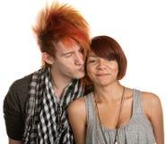 Hombre joven que besa a la novia Foto de archivo libre de regalías