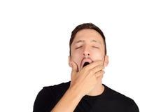 Hombre joven que bosteza imagenes de archivo