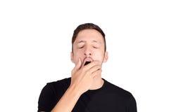 Hombre joven que bosteza fotos de archivo
