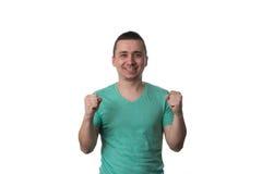 Hombre joven que celebra a Victory Isolated On White Background Fotografía de archivo libre de regalías