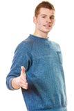 Hombre joven que da la palma para el apretón de manos Fotos de archivo