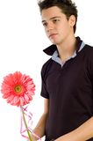 Hombre joven que da una flor Imagenes de archivo