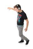 Hombre joven que disfruta de la música aislada Fotos de archivo