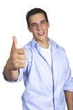 Hombre joven que gesticula los pulgares para arriba Imagen de archivo