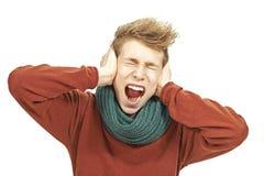 Hombre joven que grita Foto de archivo