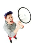 Hombre joven que grita a través del megáfono Imagen de archivo libre de regalías
