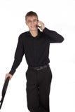 Hombre joven que habla en la diversión del teléfono Fotos de archivo libres de regalías