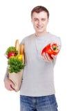 Hombre joven que hace compras Imagenes de archivo