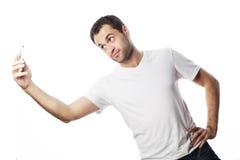 Hombre joven que hace la foto de sí mismo Imágenes de archivo libres de regalías