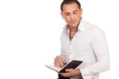 Hombre joven que hace notas Fotos de archivo