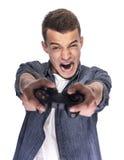 Hombre joven que juega en la consola o el ordenador Fotografía de archivo