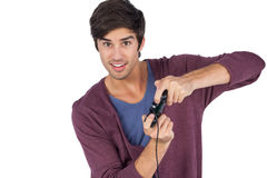 Hombre joven que juega a los videojuegos Fotografía de archivo libre de regalías