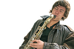 Hombre joven que juega un Saxaphone Foto de archivo