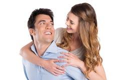 Hombre joven que lleva a cuestas a la mujer Fotografía de archivo